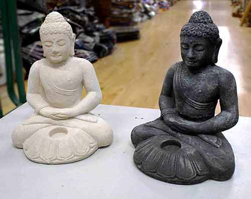 Two Buddha stone statues sitting cross-legged for sale by buying agent in indonesia Bali sourcing export.