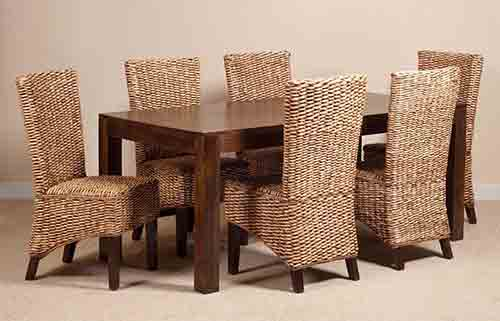 Solid wood table and six chairs made of banana leaves.