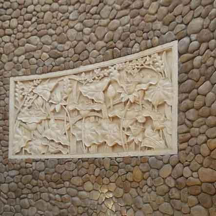 Bas-relief recessed in stone wall for sale by buying agent in Indonesia for export to Bali sourcing.