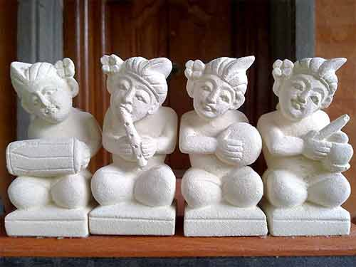 Four small white statues of Indonesian musicians for sale by buying agent in indonesia Bali sourcing .